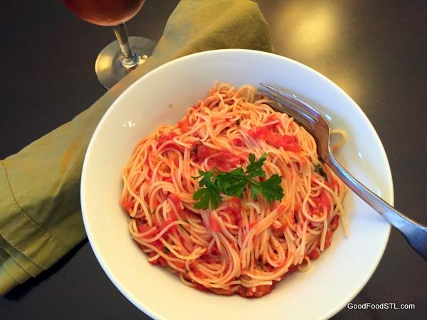 spaghetti made with fresh tomato sauce