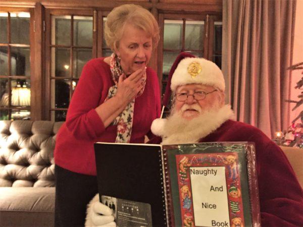 Santa reads his list