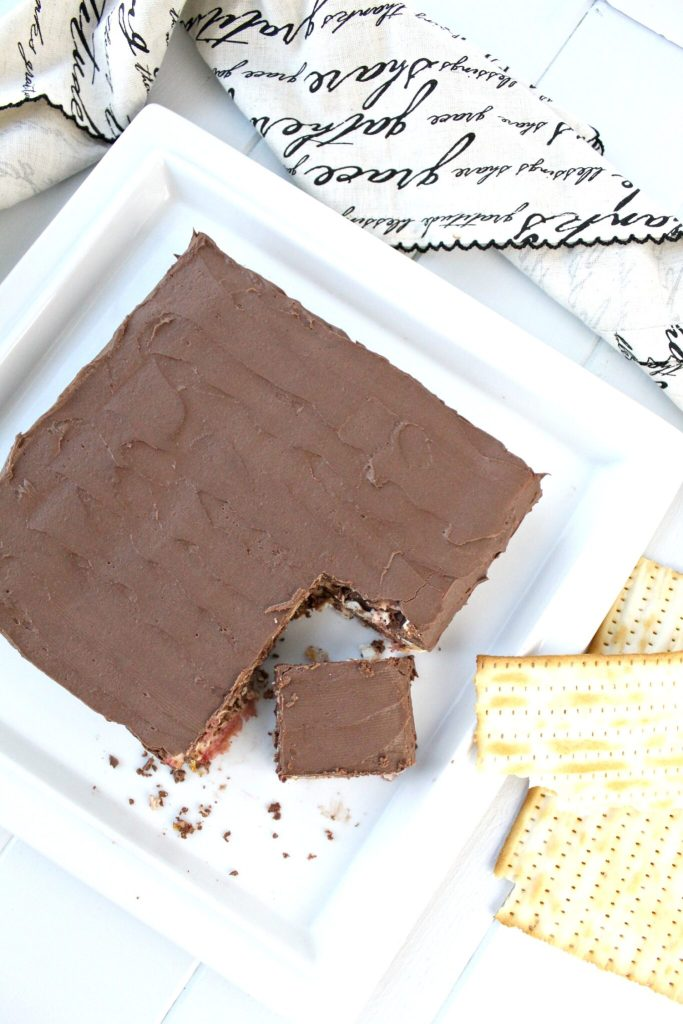 Overhead shot of layered chocolate matzah cake on serving tray