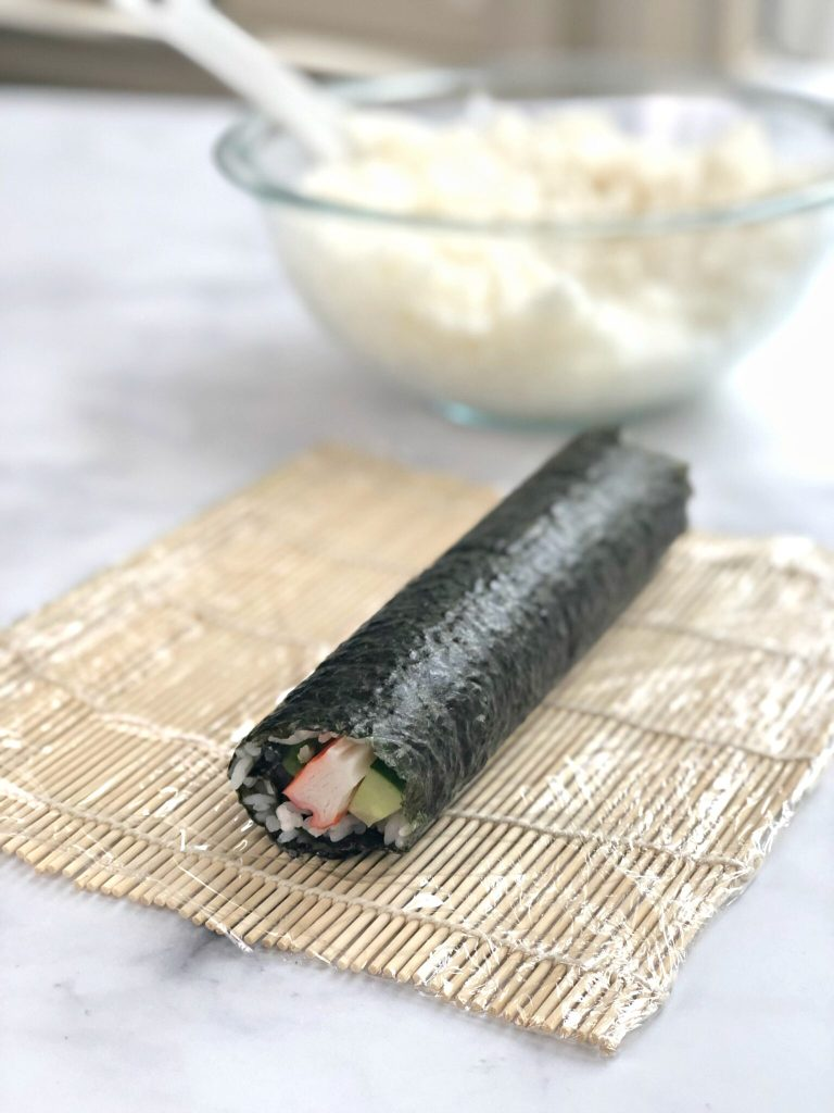 Sushi roll rolled on mat