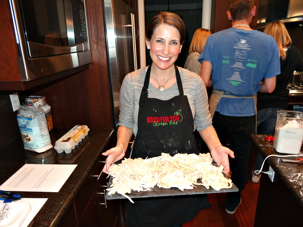Gluten-Free Cooking Classes in Denver: Jenny holding gluten-free pasta