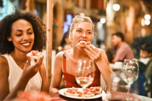 women at an event eating