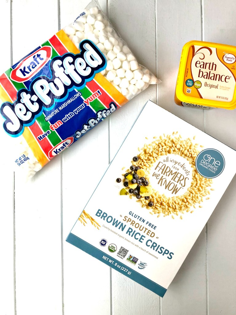 Supplies to make gluten-free Rice Krispie Treats - marshmallow bag, brown rice crisps and butter