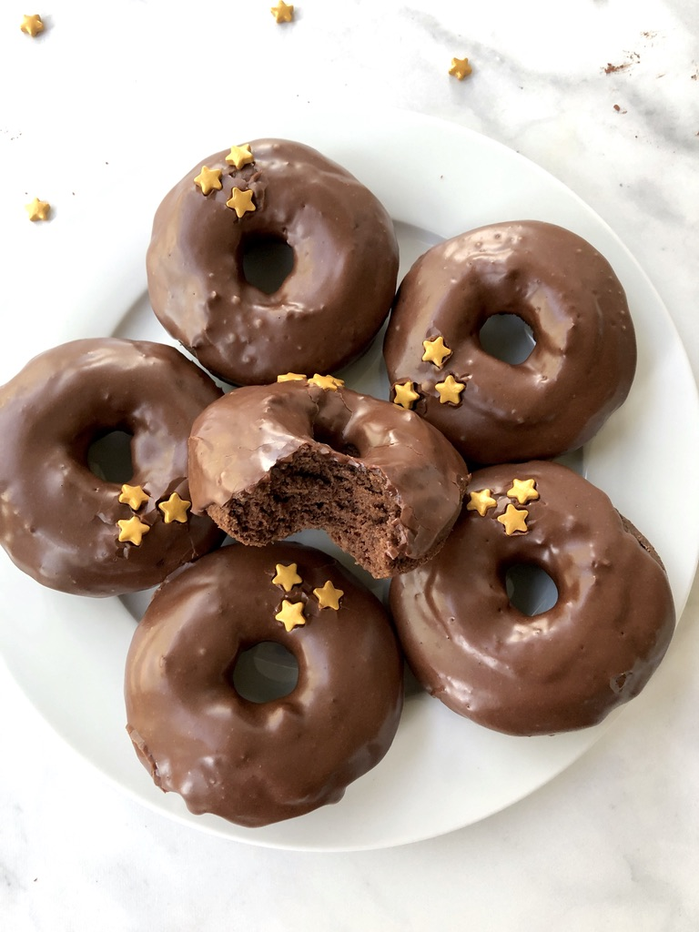 Gluten-free chocolate donuts on a plate