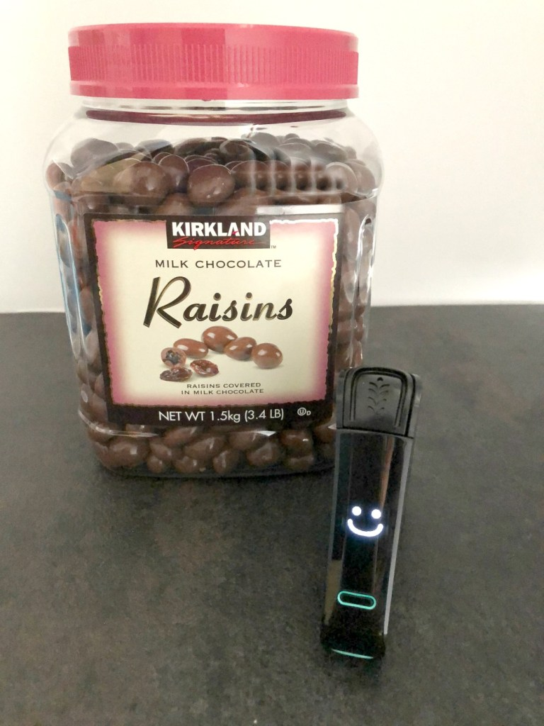 Nima displays smiley face, indicating Kirkland chocolate raisins are gluten free