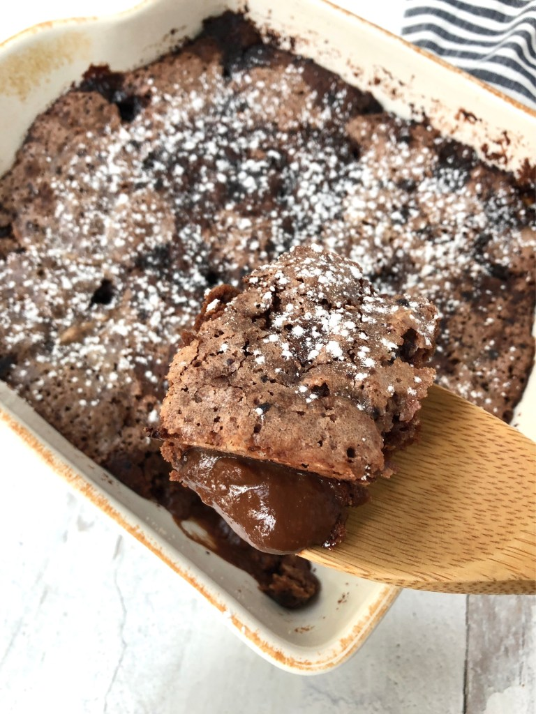 upclose image of scoop of pudding cake on a wooden spoon
