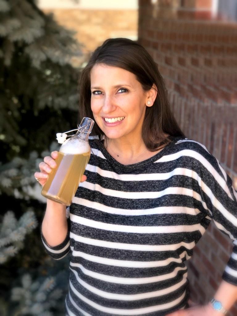 Jenny drinking kombucha