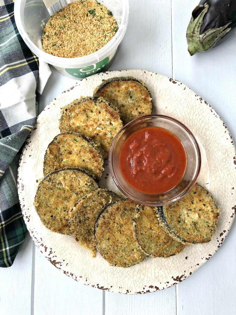 Gluten-Free Breaded Eggplant Slices on a plate with marinara dipping sauce