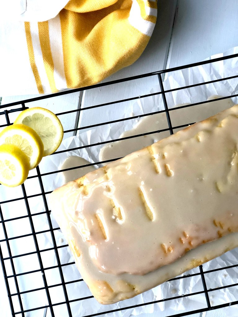 Gluten-Free Lemon-Vanilla Pound Cake overhead view with lemons in picture