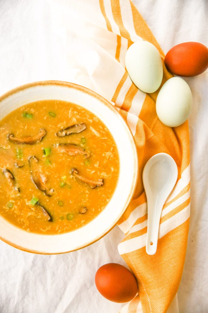 overhead happy egg drop soup with spoon and eggs