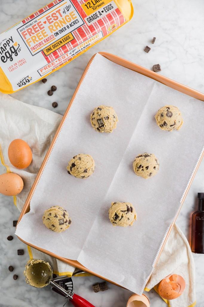 Gluten-free chocolate chunk cookie dough balls on a baking sheet