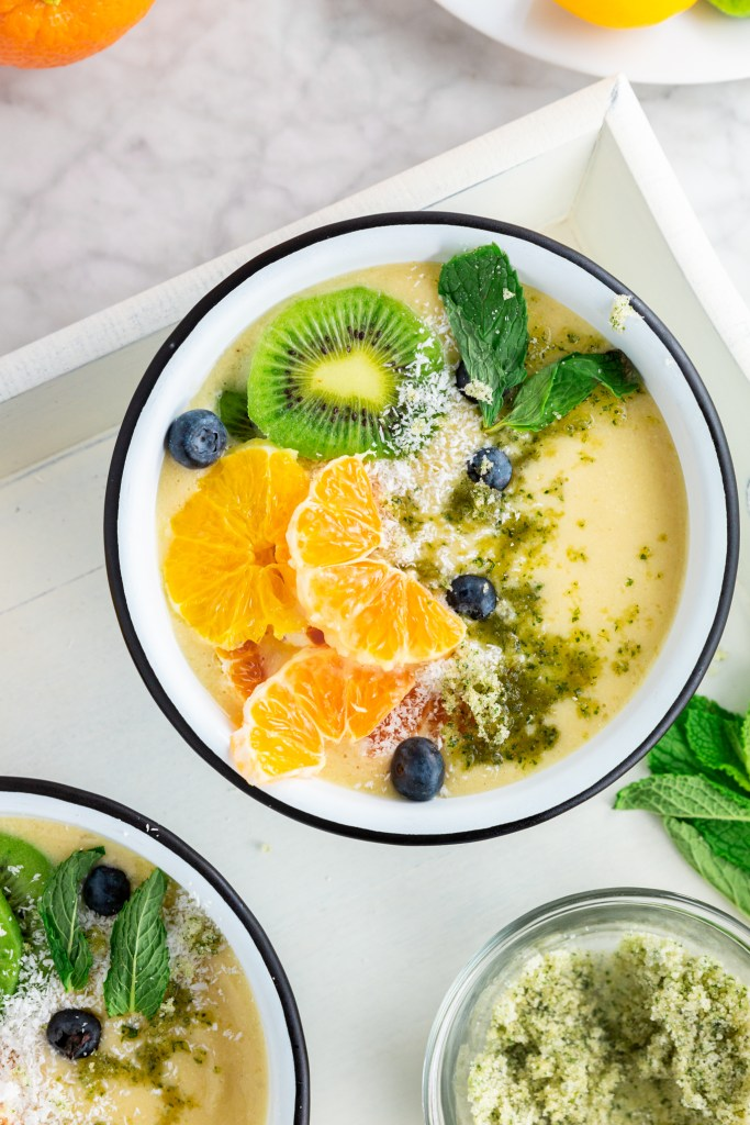 Overhead picture of Dairy-Free Citrus Mint Smoothie Bowl with all the beautiful fruits - kiwi, oranges, blueberries, etc. - 2