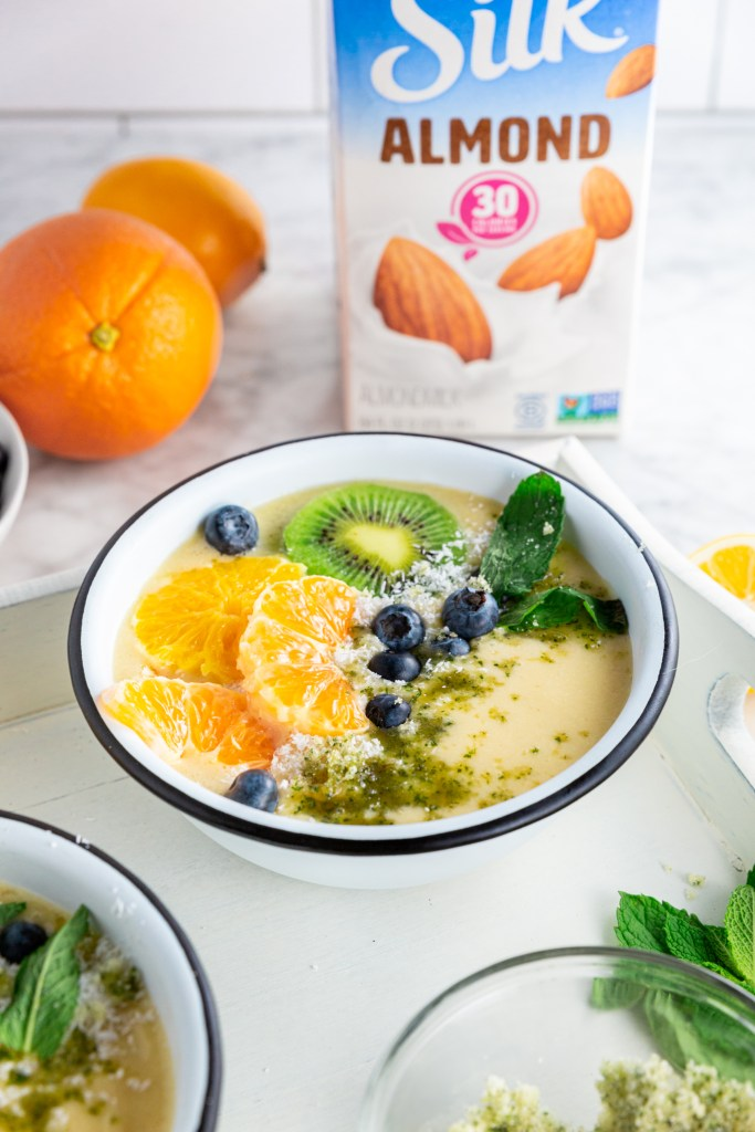 Final image of Dairy-Free Citrus Mint Smoothie Bowl with Silk almondmilk carton in background