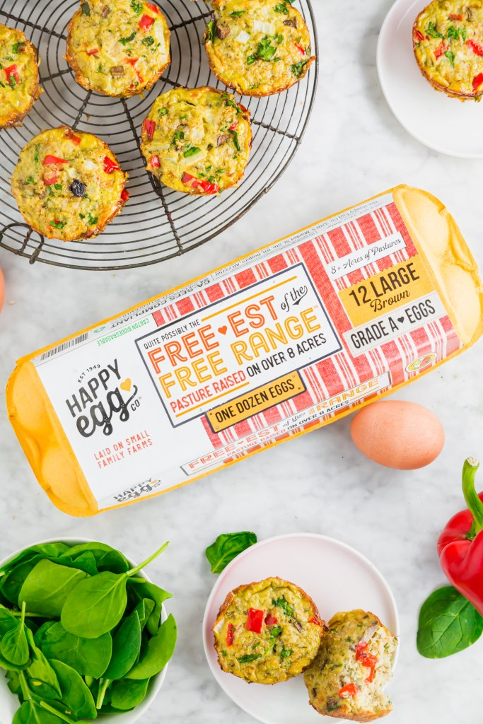 overhead shot of High-Protein Vegetable Quinoa Egg Muffins and Happy Egg Co egg carton