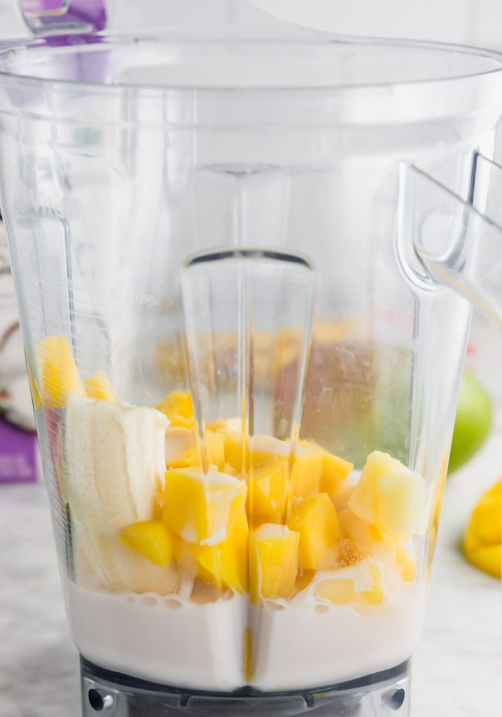 Diced mangoes, pineapple, banana and coconutmilk inside the blender