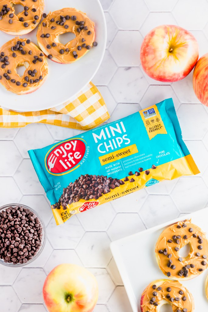 Enjoy Life mini chocolate chips with sliced apples, nut butter and chocolate chips.