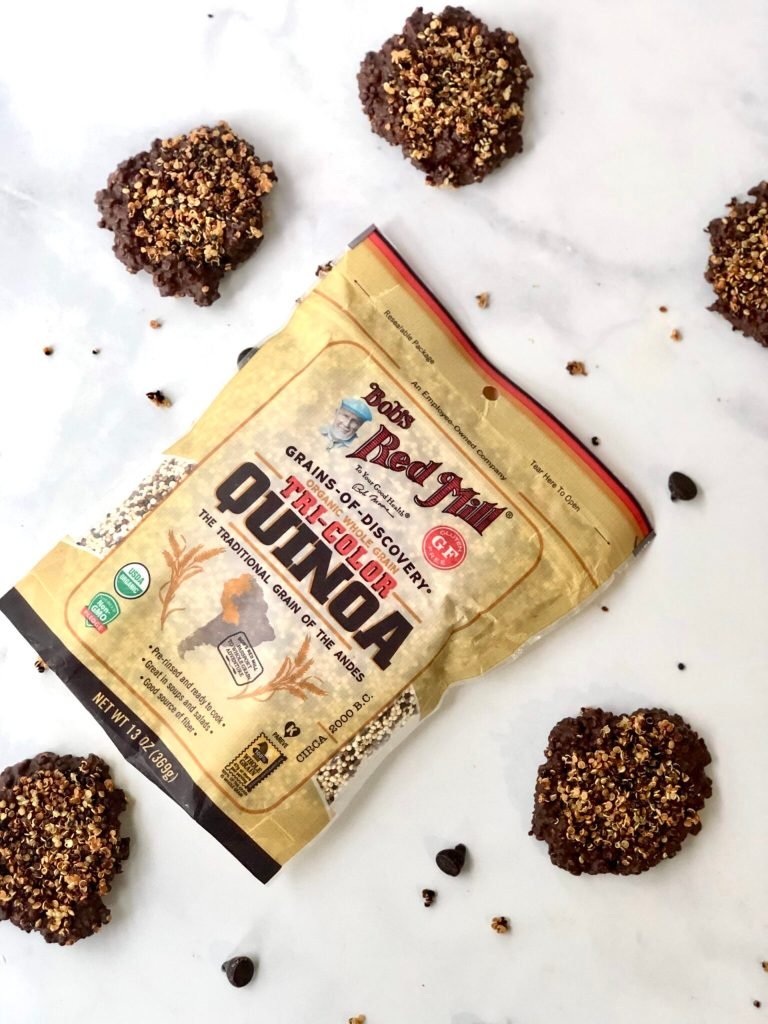 Picture of Bob's Red Mill tri-colored quinoa surrounded by chocolate covered quinoa crisps