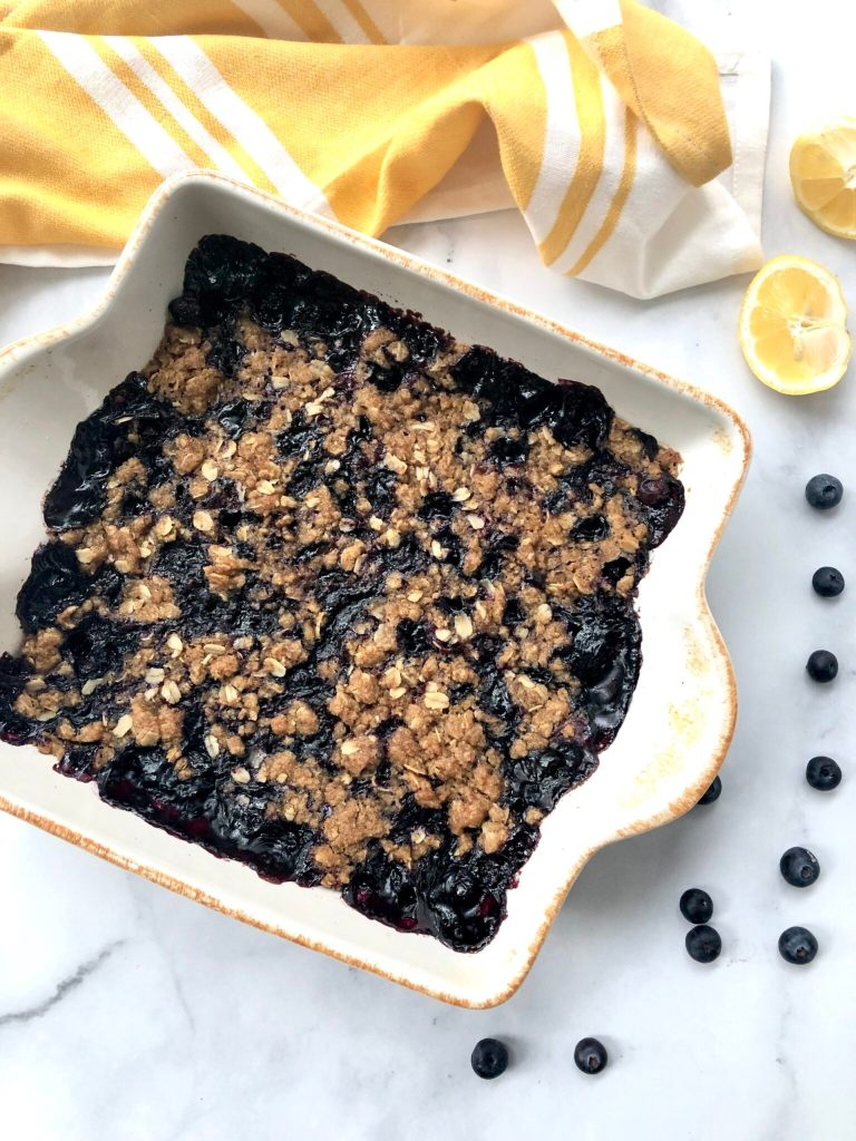Baked gluten-free blueberry crisp with oats - in a baking dish.