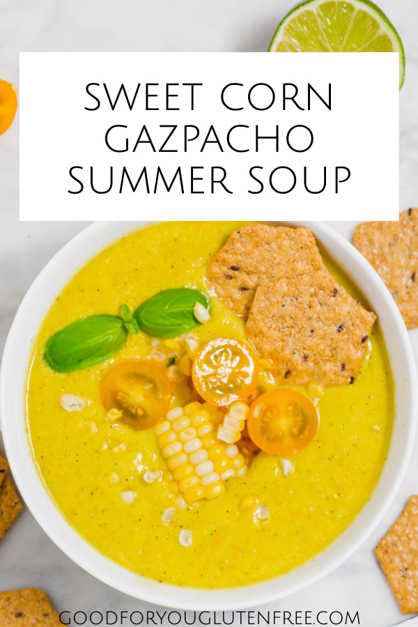 Pin image that shows up close on corn gazpacho soup with crackers, tomatoes and fresh basil shown..