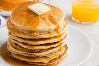 Header image of pancakes doused in maple syrup