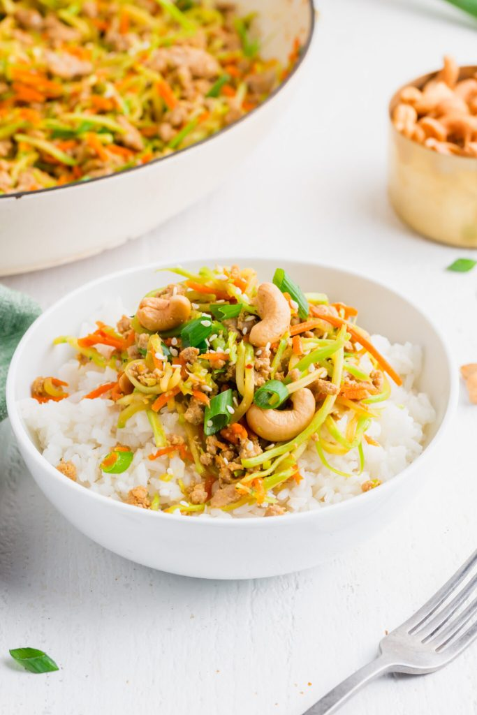 Egg roll filling served in a bowl over rice.