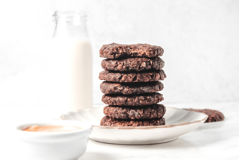 Stack of No Bake Mini Chocolate Peanut Butter Cookies with milk in background
