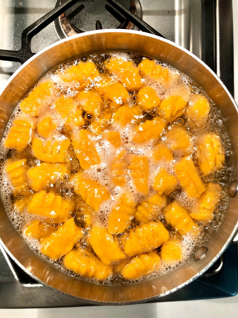 Picture of gnocchi boiling and floating to the top of the water