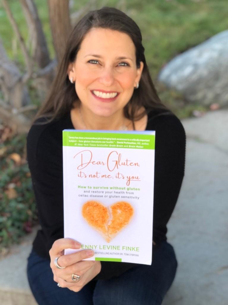 Jenny Levine Finke holding Dear Gluten, It's Not Me, It's You