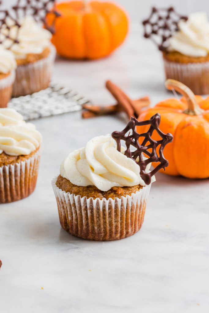 almond flour pumpkin muffin with chocolate cobweb garnish