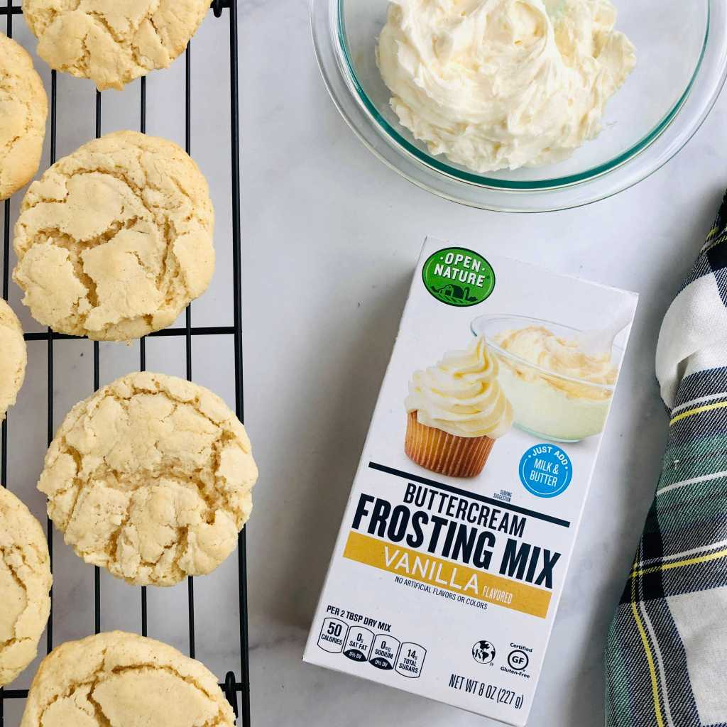 Picture of Open Nature buttercream frosting box and picture of the sugar cookies without frosting