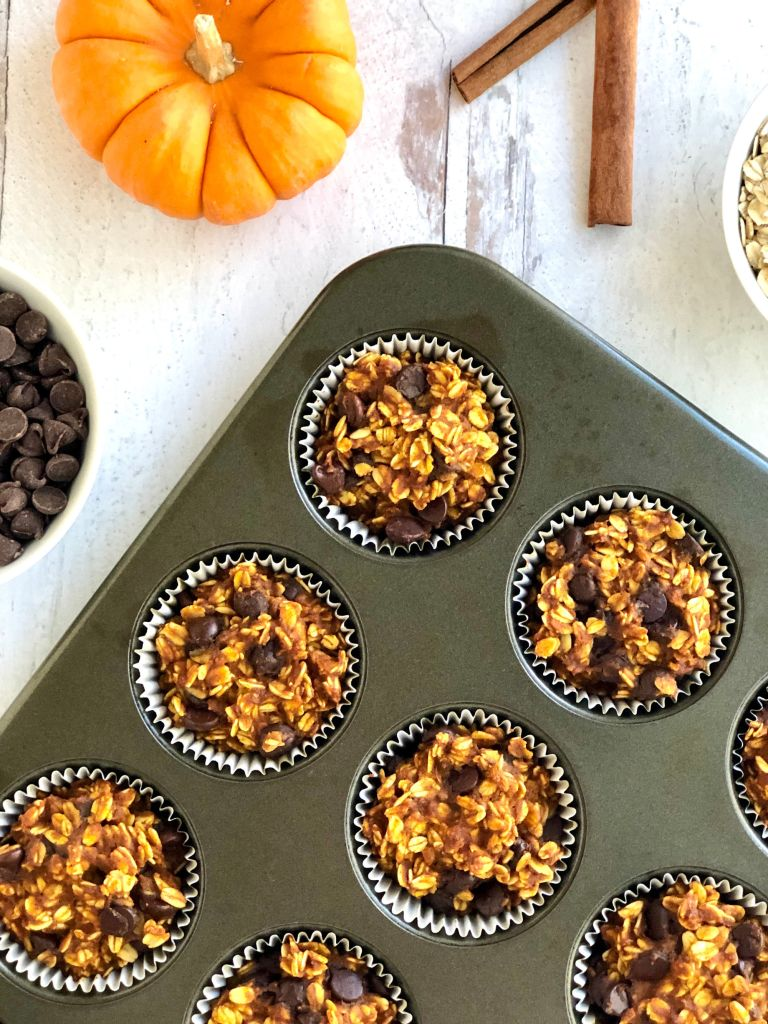 Cooked pumpkin oatmeal cups in a muffin pan