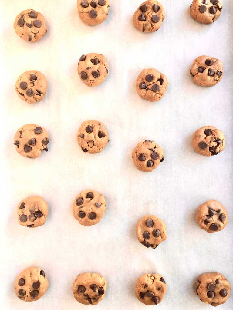 Picture of rolled dough balls with a few extra chocolate chips added in the top of each