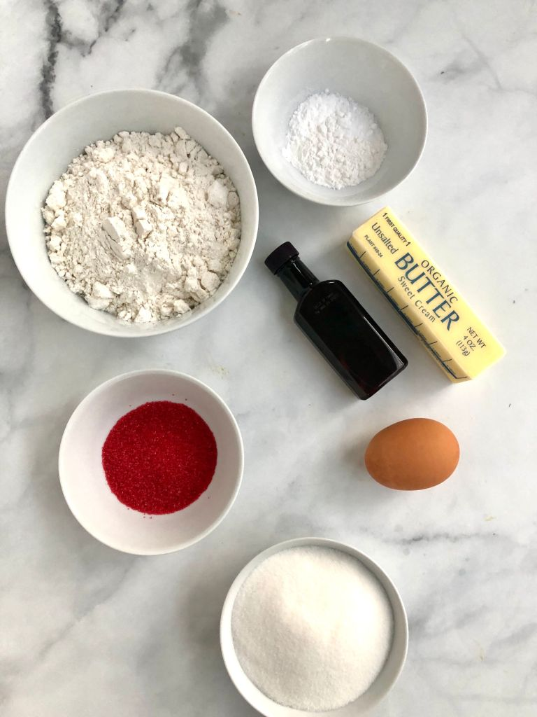 Picture of flour, butter, sugar, decorating sugar and other ingredients  needed for the recipe