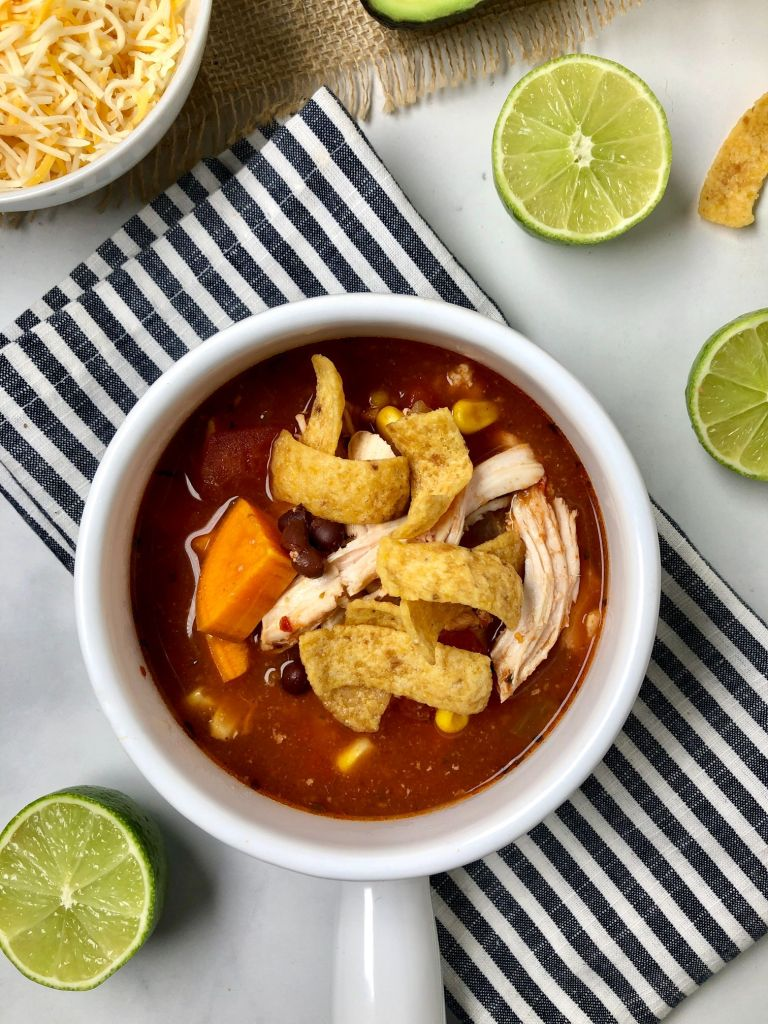 close up on the chicken enchilada soup in a bowl