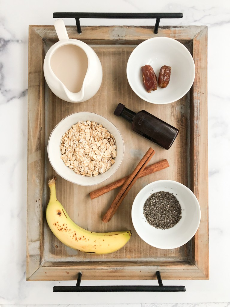 Ingredients for banana oatmeal on a tray