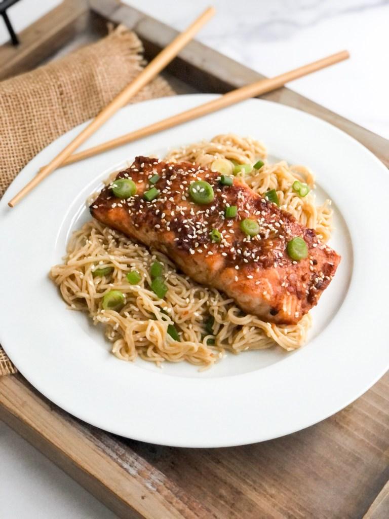 Salmon filet atop bowl of rice ramen