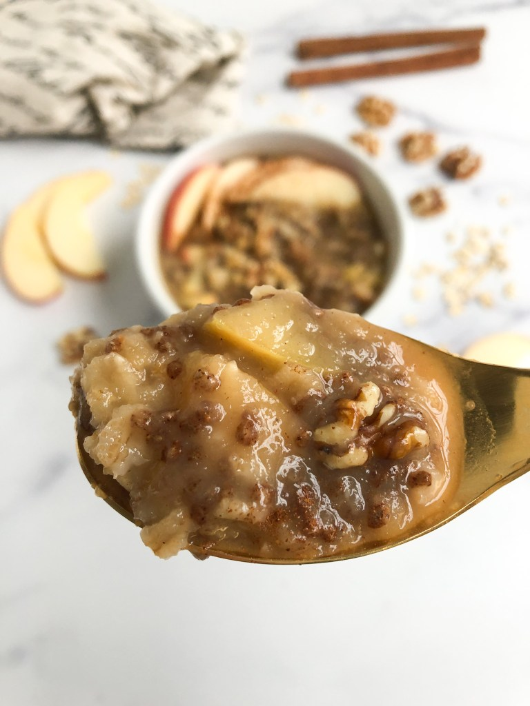 spoonful of apple pie oatmeal with chunks of visible apples