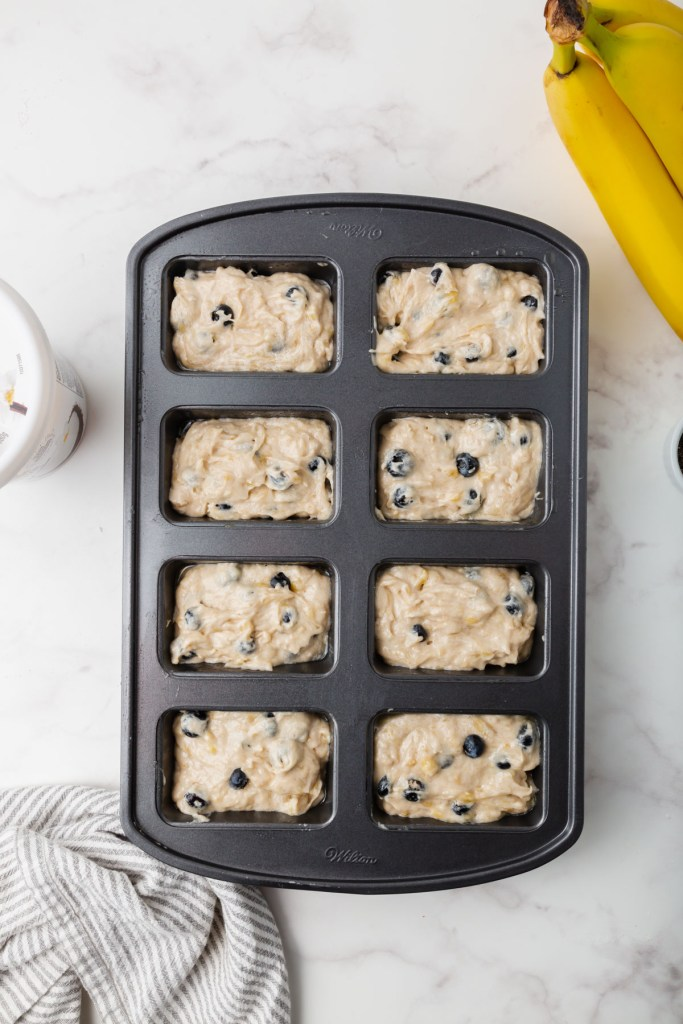 banana bread batter in mini loaves pan