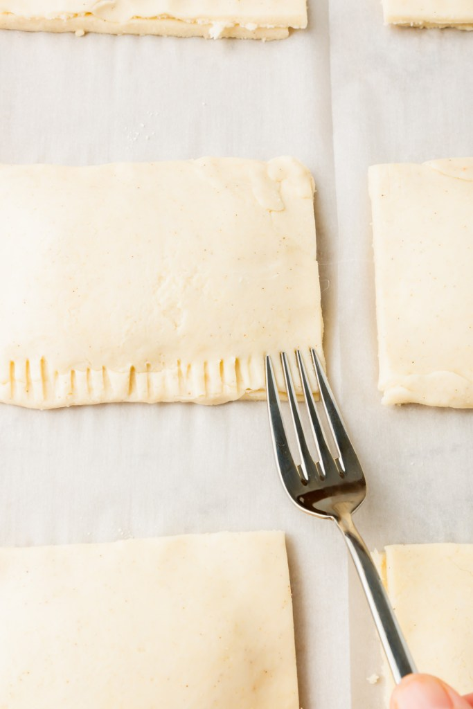 using a fork to seal the gluten-free pop tarts in place