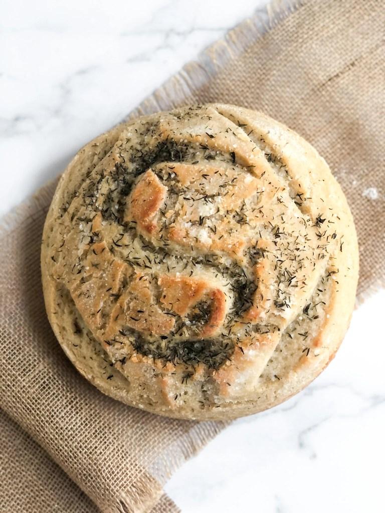 A round artisan loaf of gluten-free sourdough bread.