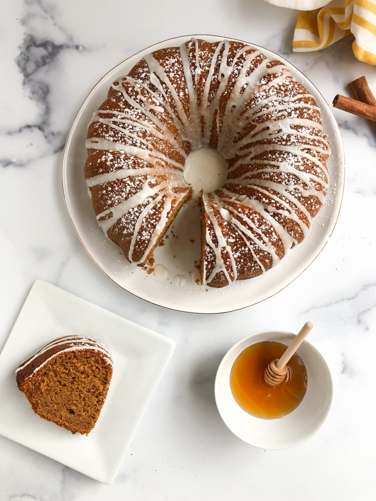 Overhead picture of gluten-free honey cake with slice of honey cake and bowl of honey