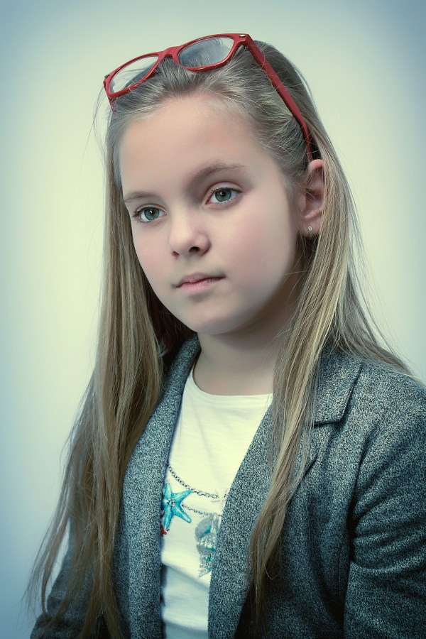 cute-young-girl-portrait-with-sunglasses-above-face image ...