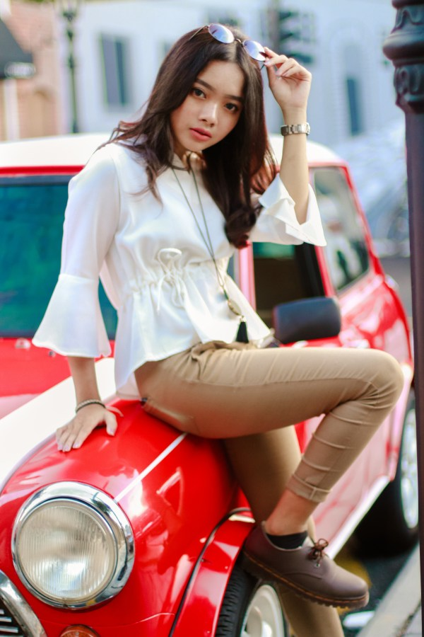 pretty-young-girl-on-red-car image - Free stock photo ...