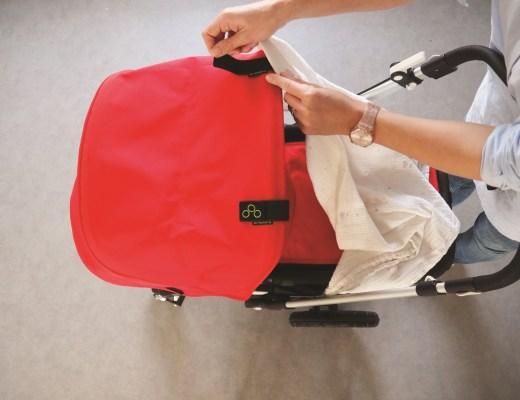 handige-babyspullen-swaddleclipp_goodgirlscompany_hydrofielluier-over-kinderwagen-gevaarlijk