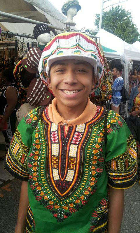 Elijah used his own money to buy a hat at the market, and I bought him a Dashiki.