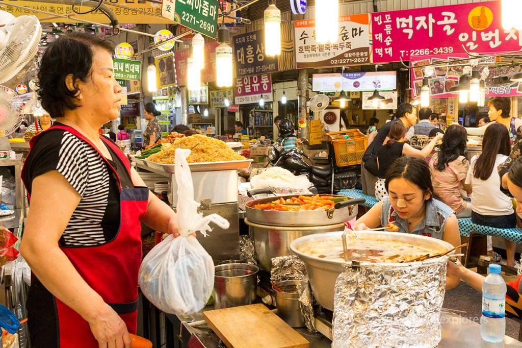 Food stall seller and dinners at Gwangjang Market Seoul South Korea