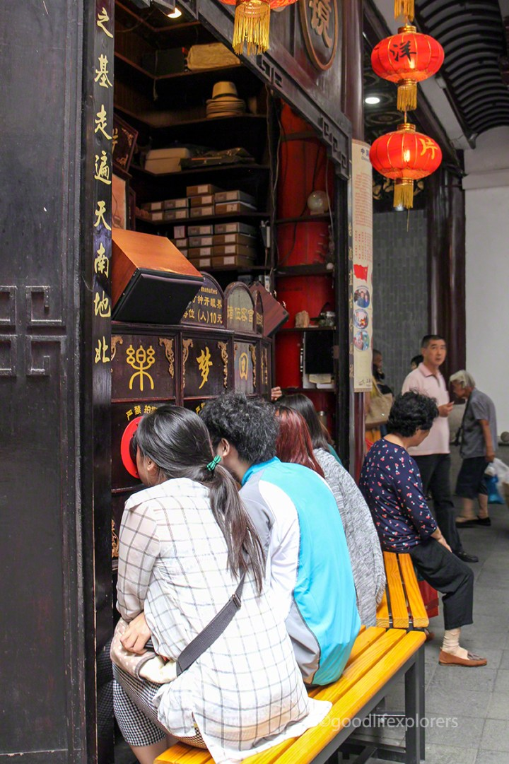 People watching puppet show in Shanghai China