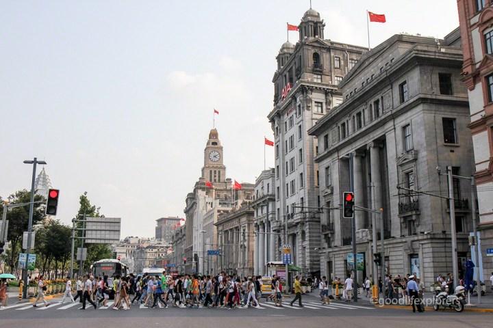 Pedestrians crossing street at The Bund neighborhood in Shanghai