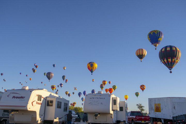 Hot air balloons over campground at Albuquerque Balloon Fiesta