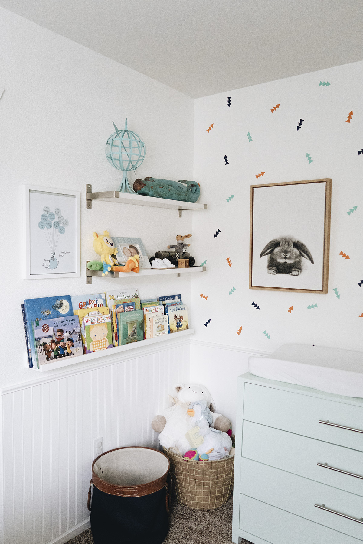 Shelves displaying books and mementos for baby nursery